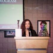 Dee Dee Irwin presenting Best Arts ProgramAward